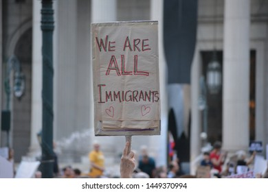 """New York City - July 12, 2019: People taking part in the """"Lights4Liberty"""" protests against President Trump's planned ICE raids against immigrants and the detention centers along the southern border."""