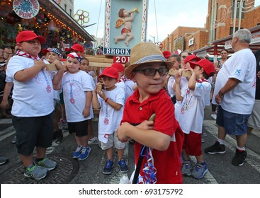 NEW YORK CITY - JULY 12 2017: Our Lady of Mount Carmel staged its annual Children's Giglio Lift in Williamsburg, Brooklyn. Capo Joseph Guidice, 7, guiding lift