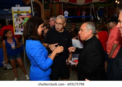 NEW YORK CITY - JULY 12 2017: Our Lady of Mount Carmel staged its annual Children's Giglio Lift in Williamsburg, Brooklyn. Republican mayoral candidate Nicole Malliotakis chats with priests