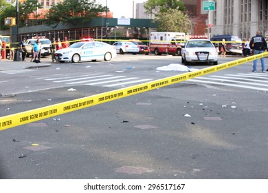 NEW YORK CITY - JULY 13 2015: NYPD collision investigators on scene at the intersection of Flatbush & Atlantic Aves where a hit & run collision led to the death of a bicyclist & multiple injuries