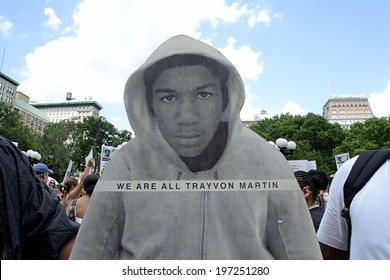 NEW YORK CITY - JULY 14, 2013: A cardboard photo-realistic figure of Trayvon Martin at a crowd gathered to peacefully protest the Trayvon Martin case in Union Square in Manhattan on July 14, 2013.