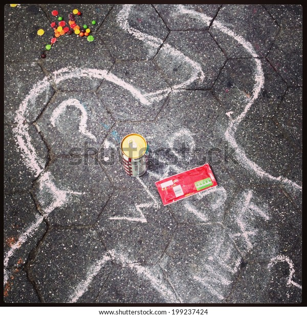 NEW YORK CITY - JULY 14, 2013: A symbolic outline representing murder in chalk at the protest the Trayvon Martin murder case in Union Square in Manhattan on July 14, 2013.