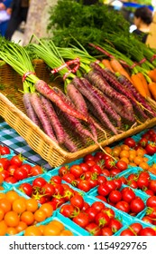 NEW YORK CITY - JULY 16, 2018:  Display of organically grown fresh produce including cherry tomatoes and carrots on display at the Union Square Greenmarket Farmer's Market in Manhattan