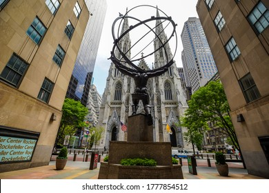 NEW YORK CITY - JULY 16, 2020:  Atlas statue by Lee Lawrie and St. Patrick's Cathedral in front of Rockefeller Center in midtown Manhattan