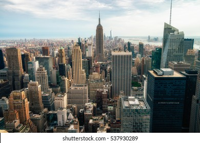 NEW YORK CITY - JULY 16,2016: Observers view Midtown from Top of the Rock Rockefeller center. Manhattan is often described as the cultural and financial capital of the world. Splittoned image.