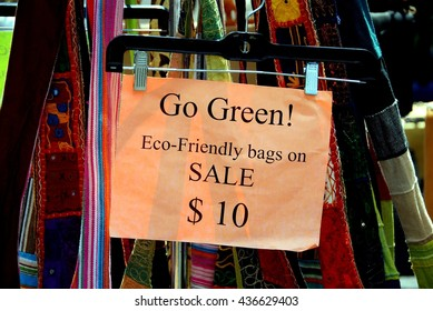 New York City - July 18, 2009:   Eco-friendly green fabric bags sold by vendors at street festival on West 14th Street