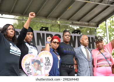 NEW YORK CITY - JULY 19 2015: National Action Network & SEIU members staged a rally to mark the anniversary of Eric Garner's death in Cadman Plaza, Brooklyn. Mothers on stage with Al Sharpton