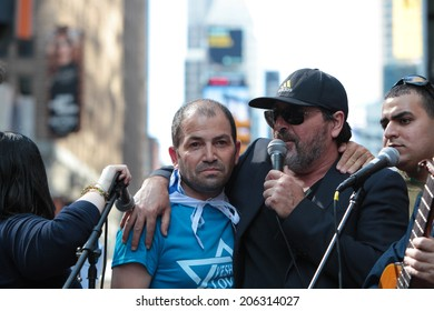 NEW YORK CITY - JULY 20 2014: several thousand supporters of Israeli actions in Gaza staged a rally in Times Square. Singer Benny Elbaz (rt) with Palestinian Christian Israel supporter