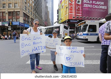 NEW YORK CITY - JULY 20 2014: several thousand supporters of Israeli actions in Gaza staged a rally in Times Square. Family attending rally with hand-lettered signs