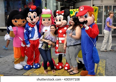 New York City - July 20, 2012:  Tourists pose for a photo with Disney's Mickey and Minnie Mouse and other characters from animated films in Times Square