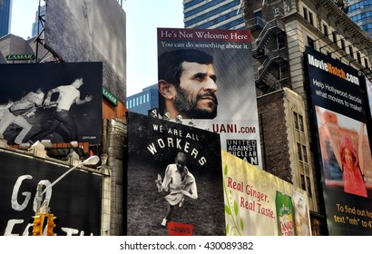 New York City - July 21, 2010:  Billboards cover facades and roofs of buildings on Broadway just north of Times Square including one featuring the face of Iran's President Mahmoud Ahmadinejad