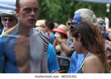 NEW YORK CITY - JULY 22 2017: Noted body artist Andy Golub staged his annual body painting exhibition in Washington Square Park with dozens of models & artists