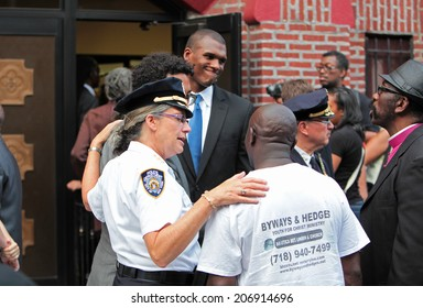 NEW YORK CITY - JULY 23 2014: Funeral services for Eric Garner, the Staten Island resident who died while being taken into custody by NYPD.  Community Affairs Bureau chief Joanne Jaffe with mourners