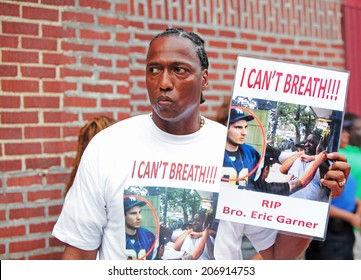 NEW YORK CITY - JULY 23 2014: Funeral services for Eric Garner, the Staten Island resident who died while being taken into custody by NYPD.  Activist with sign.