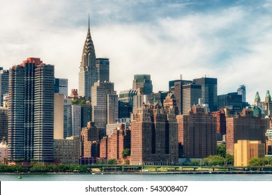 NEW YORK CITY - JULY 27, 2016: Observers view Manhattan from Brooklyn. Manhattan is often described as the cultural and financial capital of the world. Splittoned image.