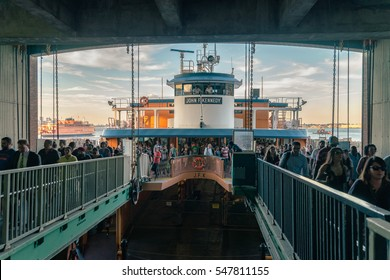 NEW YORK CITY - JULY 27, 2016: The Staten Island Ferry station. People and view from Staten Island. Vivid lowlight splittoned picture.