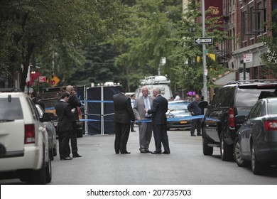 NEW YORK CITY - JULY 28 2014: NYPD personnel including Commissioner William Bratton investigate a shooting in the West Village that left one detective & two US marshals wounded & the suspect dead.