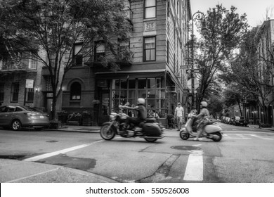 NEW YORK CITY - JULY 29, 2016: Street photo in Manhattan, New York City. People, buildings and cozy places of NYC. Low light vivid splittoned image.