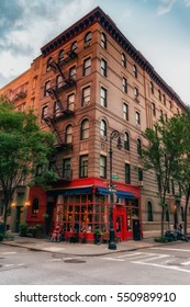 """NEW YORK CITY - JULY 29, 2016: """"Friends"""" apartment location in New York City. Itâ??s located at 90 Bedford Street at the corner of Grove Street. Low light vivid image."""
