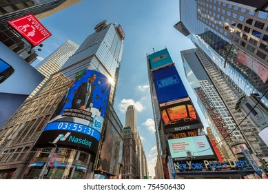 NEW YORK CITY - JULY 29, 2017: Skyscrapers and NASDAQ building of Time Square on July 29, 2017 in New York, NY. Times Square is the most visited tourist attraction in the world.