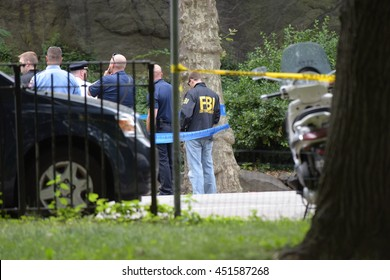 NEW YORK CITY - JULY 3 2016: NYPD emergency services, FBI & FDNY investigators closed off a portion of Central Park after an explosion blew off a young tourist's foot.
