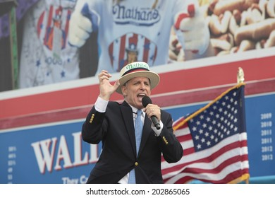 NEW YORK CITY - JULY 4 2014: Nathan's Famous held its annual Fourth of July Hotdog Eating Contest in Coney Island, Brooklyn despite moderate rain from Hurricane Arthur. George Shea.