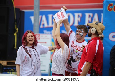 NEW YORK CITY - JULY 4 2015: Nathan's Famous staged its annual fourth of July hot dog eating contest in Coney Island, Brooklyn.Members of Direct Action Everywhere & Collectively Free disrupt event