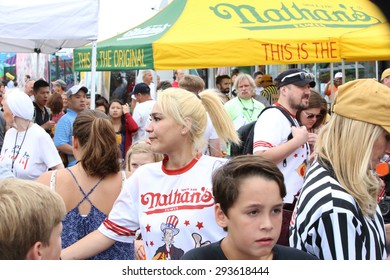 NEW YORK CITY - JULY 4 2015: Nathan's Famous staged its annual fourth of July hot dog eating contest in Coney Island, Brooklyn. Miki Sudo passing through the crowd