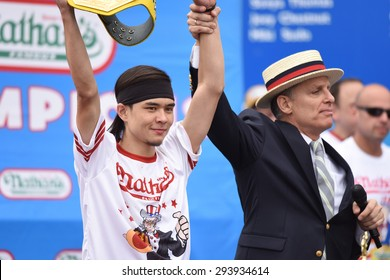 NEW YORK CITY - JULY 4 2015: Nathan's Famous held its annual fourth of July hot dog eating contest in Coney Island, Brooklyn. Matt Stonie declared winner after consuming 62 hot dogs