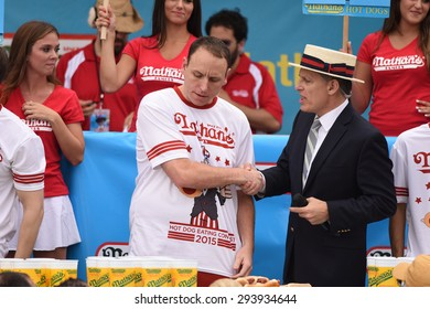 NEW YORK CITY - JULY 4 2015: Nathan's Famous held its annual fourth of July hot dog eating contest in Coney Island, Brooklyn. Promoter & MC George Shea greets defending champion Joey Chestnut