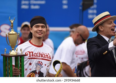 NEW YORK CITY - JULY 4 2015: Nathan's Famous held its annual fourth of July hot dog eating contest in Coney Island, Brooklyn. Winner Matt Stonie with trophy