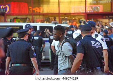 NEW YORK CITY - JULY 7 2016: Several thousand activists rallied & marched to protest recent police-involved shootings in Minnesota & Louisiana. Arrest for disorderly conduct.