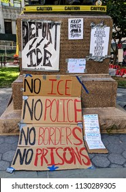 "New York City, July 9, 2018 - Members of the ""Occupy"" movement encamped at Foley Square in Lower Manhattan with signs against ICE and current immigration policies in the United States."
