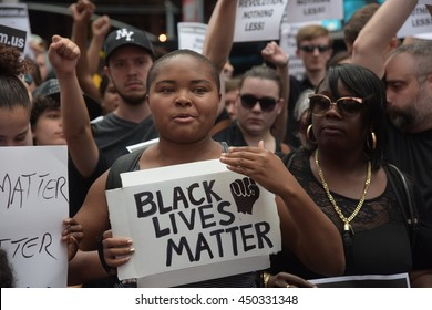 NEW YORK CITY - JULY 9 2016: Several hundred activists gathered for a rally & march in Times Square to protest alleged police brutality in the deaths of several African-American men.