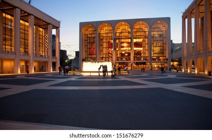 NEW YORK CITY - JUNE 07: Lincoln Center for the Performing Arts at dusk, with crowds in front of water fountains on June 07, 2012 in Manhattan, New York City.