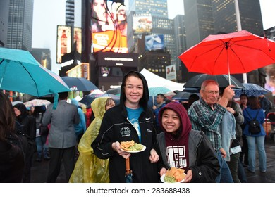 NEW YORK CITY - JUNE 1 2015: the 22nd annual Taste of Times Square brought more than 50 local restaurants & hotels together where thousands braved the rain to sample their offerings