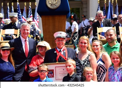 NEW YORK CITY - JUNE 1 2016: Mayor de Blasio & Commissioner Daniel Nigro presided over FDNY medal day on the steps of city hall. Firefighter Lt accepts award with family, mayor & commissioner