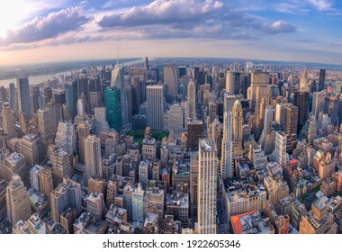 NEW YORK CITY - JUNE 10, 2013: Panoramic aerial view of Manhattan from a city rooftop at sunset.