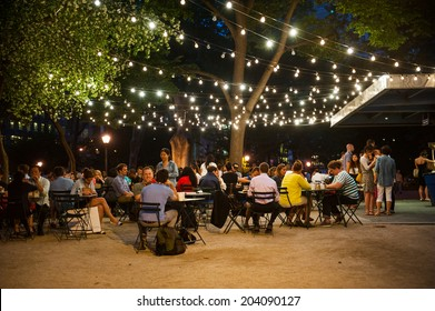 NEW YORK CITY - June 10: Customers dine at Shake Shack in Madison Square Park June 10, 2014 in New York, NY. The chain diner opened in 2004 and the Madison Square Park location is the original.