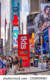 NEW YORK CITY - JUNE 11, 2013: Tourists crowded in Times Square, famous tourist attraction.