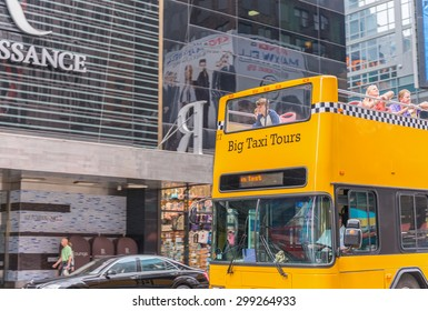 NEW YORK CITY - JUNE 11, 2013: Yellow checkered bus in Manhattan. The bus is a famous tourist attraction.