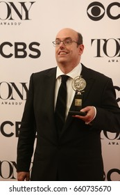 NEW YORK CITY - JUNE 11 2017: the 71st annual Tony Awards recognized the best in live theater. Director Christopher Ashley with award for Come From Away