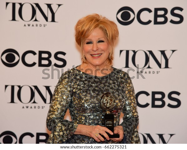 NEW YORK CITY - JUNE 11 2017: the 71st annual Tony Awards recognized the best in live theater. Bette Midler posing with her Tony for Hello, Dolly!