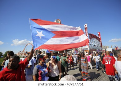 NEW YORK CITY - JUNE 12 2016: thousands filled the streets of Manhattan & Brooklyn to celebrate NYC's 59th annual Puerto Rico Day. Puerto Rico flag on Coney Island boardwalk