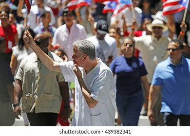 NEW YORK CITY - JUNE 12 2016: thousands filled the streets of Manhattan & Brooklyn to celebrate NYC's 59th annual Puerto Rico Day. NYC mayor Bill de Blasio greets parade watchers