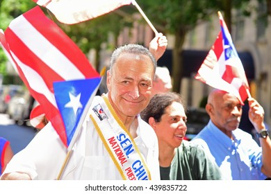 NEW YORK CITY - JUNE 12 2016: thousands filled the streets of Manhattan & Brooklyn to celebrate NYC's 59th annual Puerto Rico Day. US senator Charles Schumer with flags