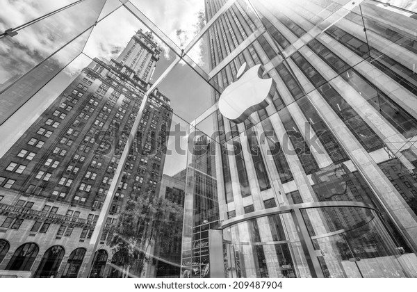 NEW YORK CITY - JUNE 12, 2013: Glass cube building of Apple Store on Fifth Avenue. The cube of glass entrance was designed by Bohlin Cywinski Jackson and has received numerous architectural awards