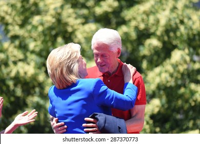 NEW YORK CITY - JUNE 13 2015: former secretary of state Hillary Rodham Clinton hugs her husband Bill Clinton as she formally announces her intention to seek the 2016 Democratic nomination for president during a rally on Roosevelt Island