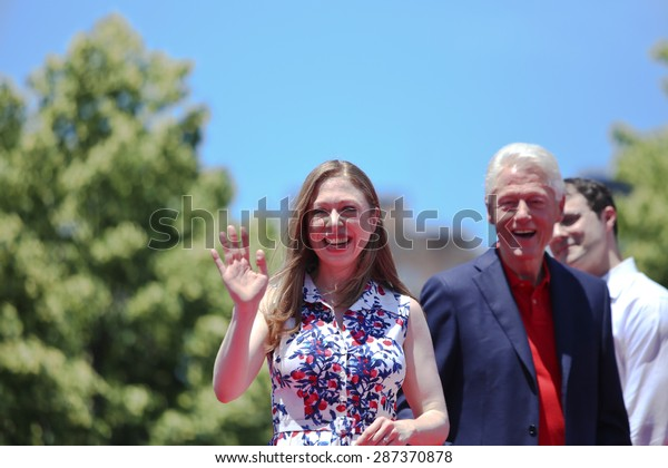 NEW YORK CITY - JUNE 13 2015: Chelsea Clinton and Bill Clinton support former secretary of state Hillary Rodham Clinton as she formally announces her intention to seek the 2016 Democratic nomination for president during a rally on Roosevelt Island