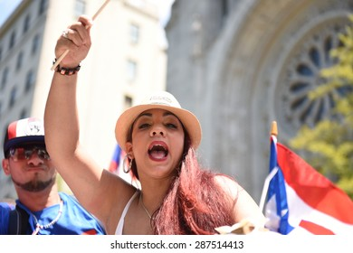 NEW YORK CITY - JUNE 14 2015: the 57th annual Puerto Rico Day parade along 5th Avenue in Manhattan is North America's largest, drawing over a million spectators.